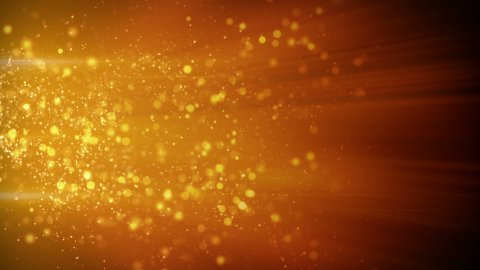 springing gold particles in light beams loop - stock footage