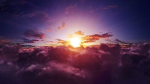 Flight through the sunset clouds. Easy to loop. 4k - Ultra HD. - stock footage