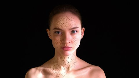Girl with dry skin on face turns into beautiful woman with perfect complexion. - stock footage