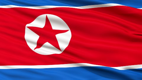 Close Up Waving National Flag of North Korea - stock footage
