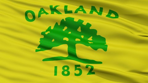 Close Up Waving National Flag of Oakland City - stock footage