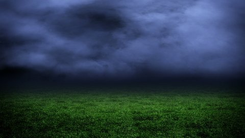 Stormy clouds and green grass - stock footage