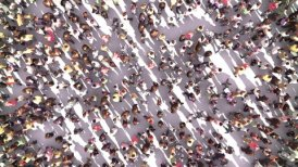 Large Anonymous Crowd Zoom Out - motion graphic