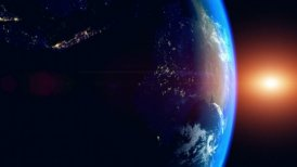 Sunrise Over The Earth. Globe with City Lights. View Of Planet Earth From Space.