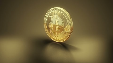 Rotating Bitcoin - Bit Coin BTC on the Gold Background. Loop, Luma Matte. - stock footage