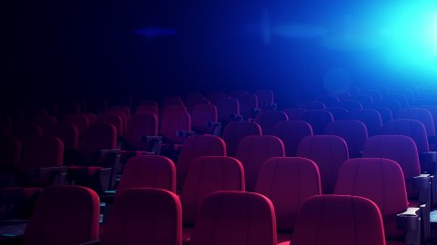 Cinema Theater With Comfortable Red Chairs. Seamless Loop. - stock footage