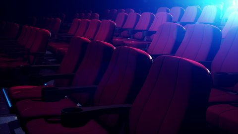 Rows Of Comfortable Red Chairs In Dark Cinema Theater. Loop. - stock footage