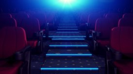 Rows Of Red Chairs In Dark Cinema Theater. Camera Goes Up. Loop.