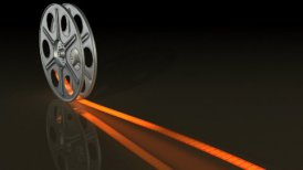 film reel with hot movie on reflective ground