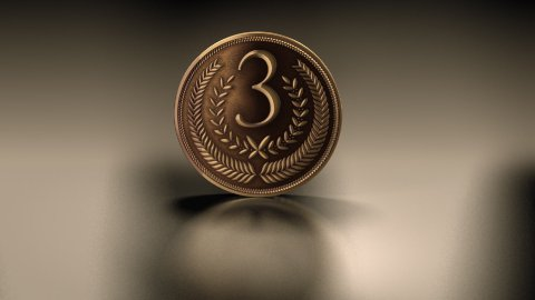 bronze medal on reflective background - stock footage