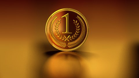 gold medal on reflective background - stock footage