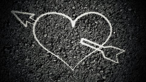 heart graffiti on asphalt - stock footage