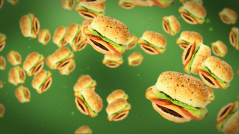 Cheeseburgers flying on green - stock footage