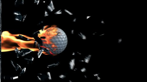 GolfBall on fire breaking glass - stock footage