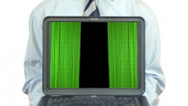 Businessman holding a laptop with opening theater green curtains - motion graphic