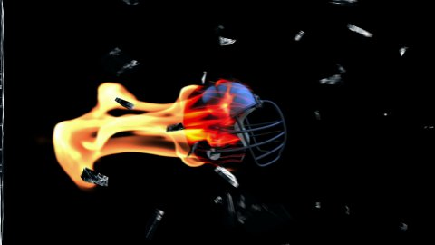 Football-Helmet on fire breaking glass with Alpha - stock footage