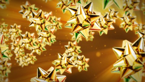 Golden gift ribbon flying - stock footage