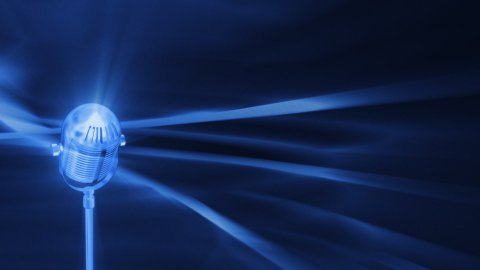 Blue FX Background with rotating vintage microphone,seamless loop - stock footage