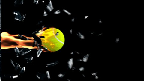 Tennis-Ball on fire breaking glass - stock footage